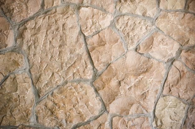 Textur der wilden steinmauer mit platz für text Premium Fotos