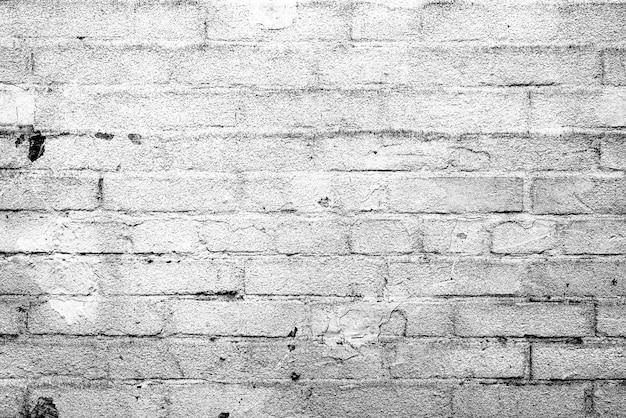 Textur einer mauer mit rissen und kratzerhintergrund Premium Fotos
