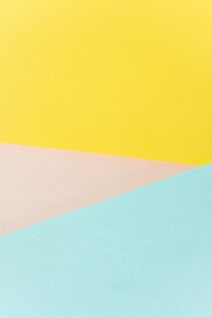 Textur papier gelb, rosa und blau. Premium Fotos