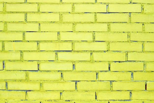 Textur und hintergrund des ziegels mit gelber farbe. Premium Fotos