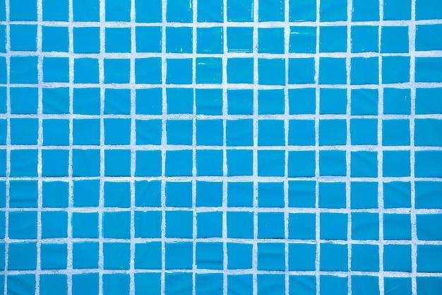 Textur von feinen kleinen keramikfliesen. blaue bodenfliesen Premium Fotos