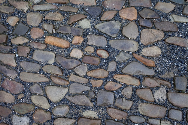 Textur von steinpflasterfliesen kopfsteinpflastersteinen hintergrund Premium Fotos