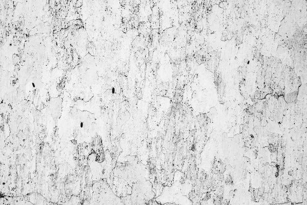 Textur, wand, beton, es kann als hintergrund verwendet werden. wandfragment mit kratzern und rissen Premium Fotos