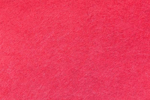 Texturhintergrund aus rotem samt oder flanell als hintergrund- oder tapetenmuster für die dekoration Premium Fotos