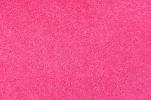 Texturhintergrund von rosa samt oder flanell als hintergrund- oder tapetenmuster für dekoration Premium Fotos