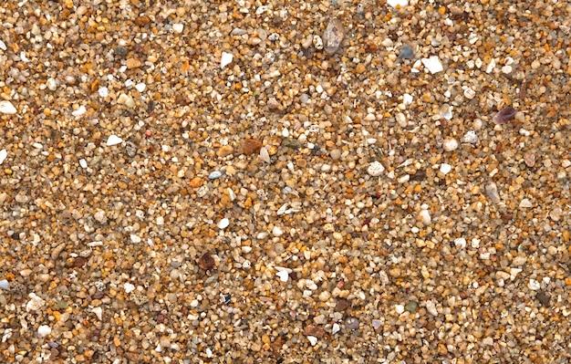 Texturiert von groben kieselsteinen am strand von samui. Kostenlose Fotos