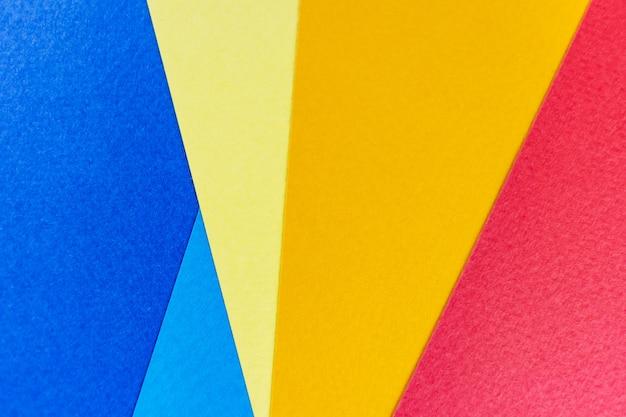 Texturpapier gelb, rot und blau. Premium Fotos
