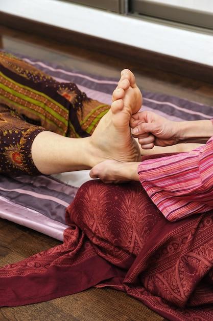 Thai massage füße Premium Fotos