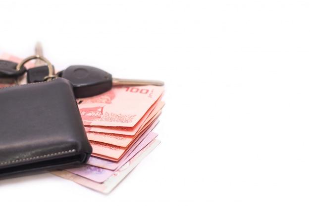 Thailändische banknoten und geldbörse Premium Fotos