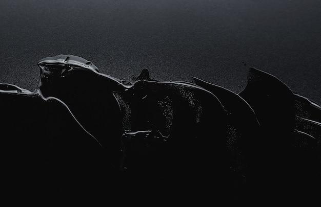 Transparente gelcremetextur mit einem schwarzen hintergrund Premium Fotos