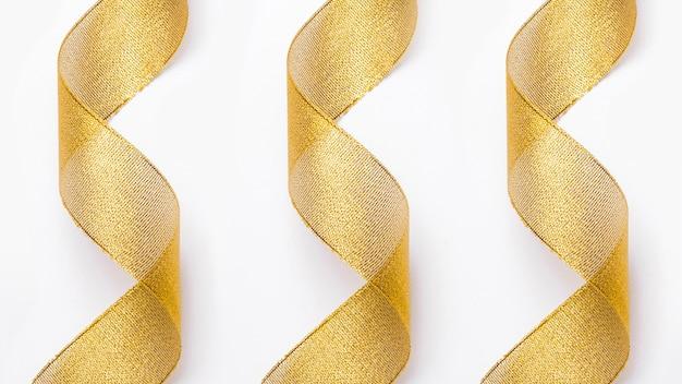 Transparente goldene bänder im hintergrund Kostenlose Fotos