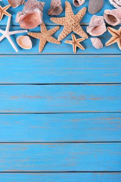 Tropische strandsommerstarfish-hintergrundgrenzvertikale Premium Fotos