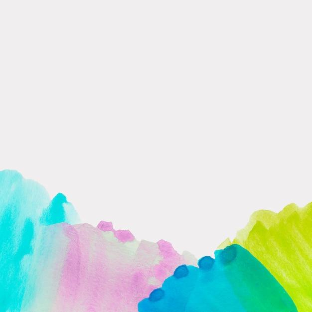 Türkis; rosa; blauer und grüner aquarellpinselanschlag auf weißem hintergrund Kostenlose Fotos