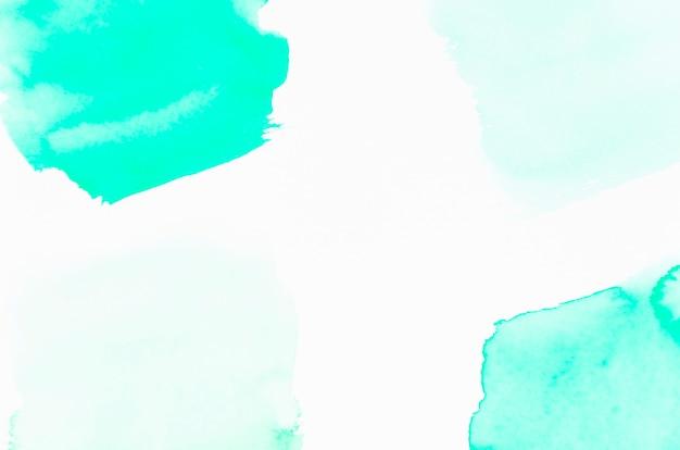 Türkisaquarelldesign auf weißem hintergrund Kostenlose Fotos