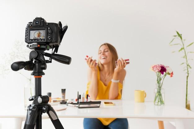 Tutorial zum filmen von make-up in der vorderansicht Kostenlose Fotos