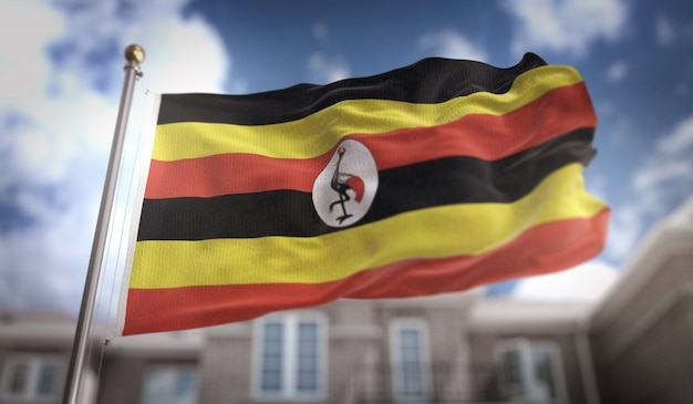 Uganda-flagge 3d-rendering auf blauem himmel gebäude hintergrund Premium Fotos