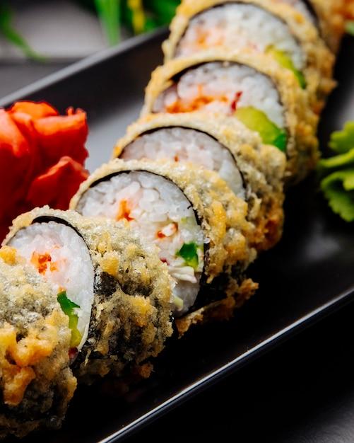 Unagi maki tempura gurke reis aal frischkäse ingwer seitenansicht Kostenlose Fotos