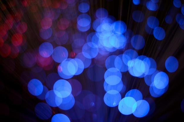 Unscharfe abstrakte rosa und blaue bokeh lichter. Premium Fotos