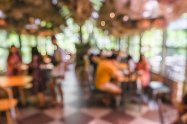 Unscharfe grüne nautre kaffeestube oder caférestaurant Premium Fotos