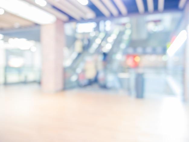Unscharfe rolltreppe im einkaufszentrum als hintergrund Premium Fotos