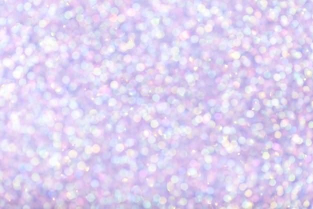 Unscharfer glänzender lila hintergrund mit funkelnden lichtern. Premium Fotos