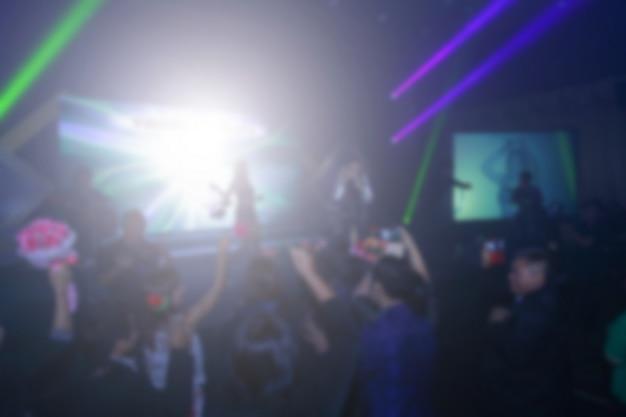Unscharfer hintergrund des ereigniskonzerts oder der siegerehrung mit beleuchtung am konferenzsaal Premium Fotos