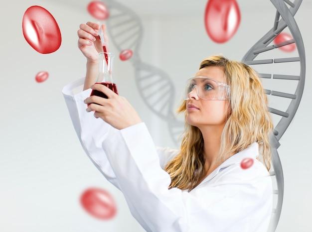 Untersuchungsblut des weiblichen wissenschaftlers Premium Fotos