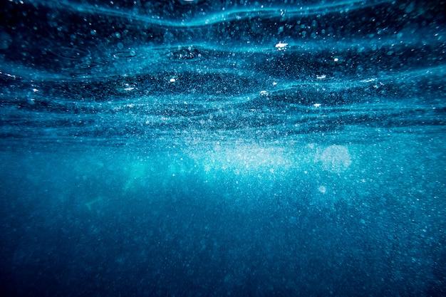 Unterwasserwellenoberflächenhintergrund Premium Fotos