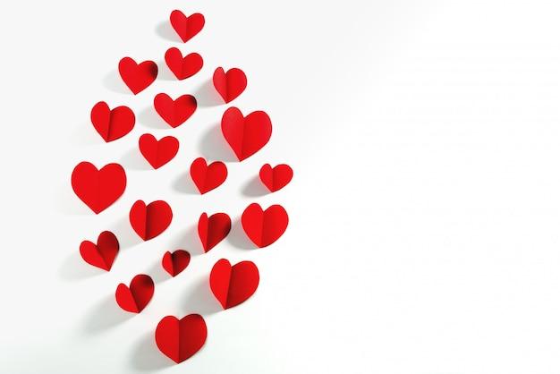 Valentinsgrußkarte mit rotem herzen auf weißem hintergrund, zusammenfassung, ebenenlage, draufsicht Premium Fotos
