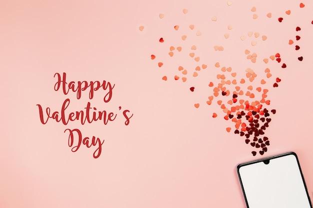 Valentinskarte mit leerem telefonbildschirm und glitzer. alles gute zum valentinstag text. hochwertiges foto Premium Fotos