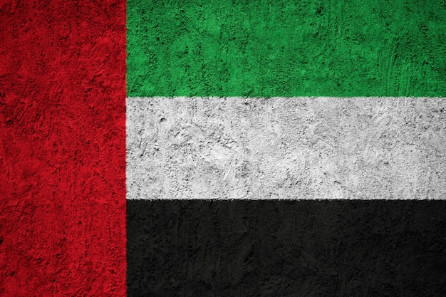 Vereinigte arabische emirate-flagge auf grunge wand gemalt Premium Fotos