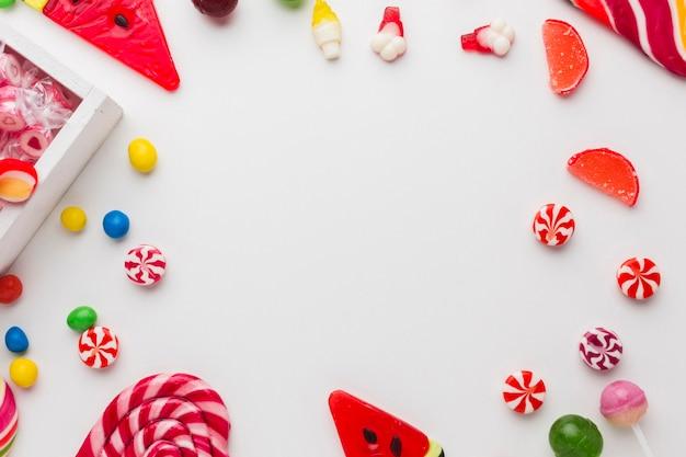 Verschiedene arten von süßigkeiten mit textfreiraum Kostenlose Fotos