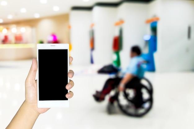 Verschwommene bilder von behinderten, die lottoscheine verkaufen Premium Fotos