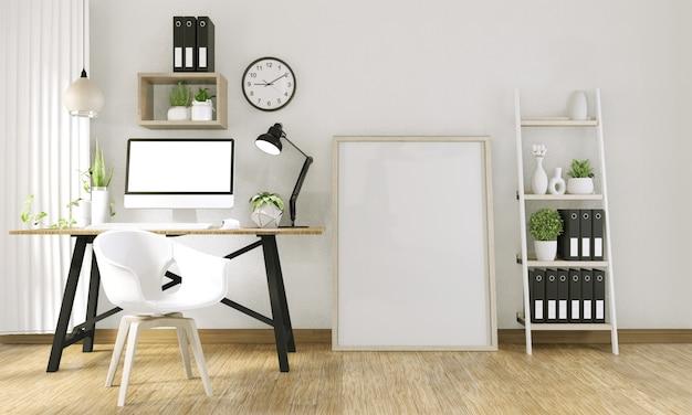 Verspotten sie herauf computer mit leerem bildschirm und dekoration im büroraumspott herauf hintergrund wiedergabe 3d Premium Fotos