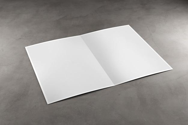Verspotten sie oben von einer broschüre auf einem konkreten hintergrund - wiedergabe 3d Premium Fotos
