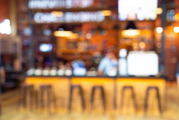 Verwischen sie die leute im café, restaurant Premium Fotos