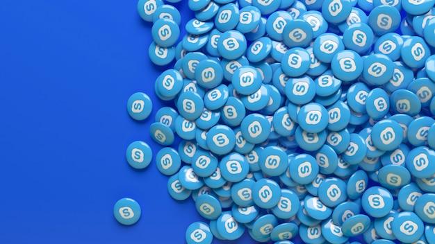 Viele glänzende 3d-skype-pillen über einem blauen hintergrund Premium Fotos