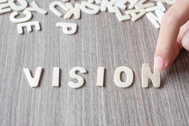 Vision-wort von buchstaben des hölzernen alphabetes. geschäfts- und ideenkonzept Premium Fotos