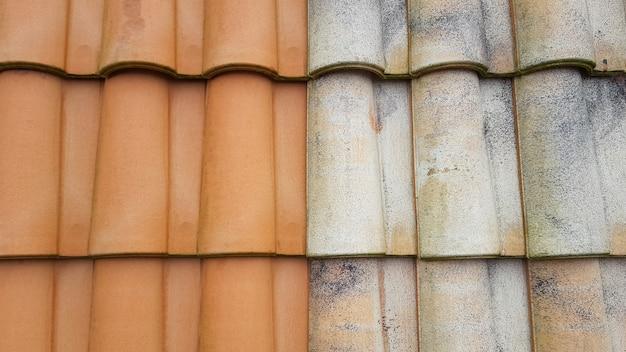 Vor und nach hochdruckwasserreinigerziegel dachreinigungsvergleich Premium Fotos
