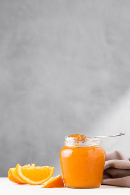 Vorderansicht der orange marmelade im klaren glas Kostenlose Fotos