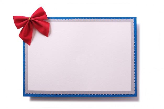 Vorderansicht der roten bogendekoration der weihnachtskarte Kostenlose Fotos