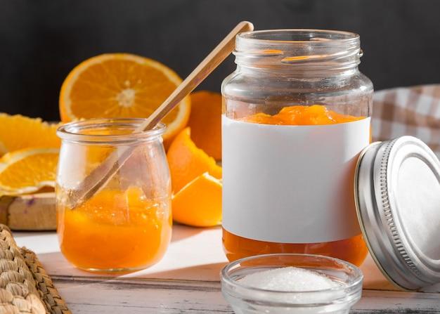 Vorderansicht des transparenten glases mit orangenmarmelade Kostenlose Fotos