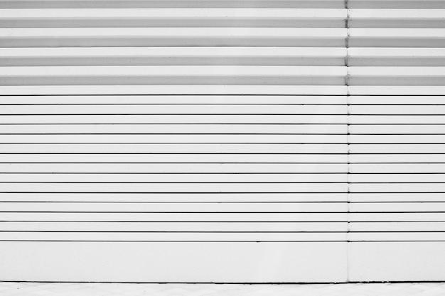 Wandhintergrund der geometrischen linien des weißen metalls Premium Fotos