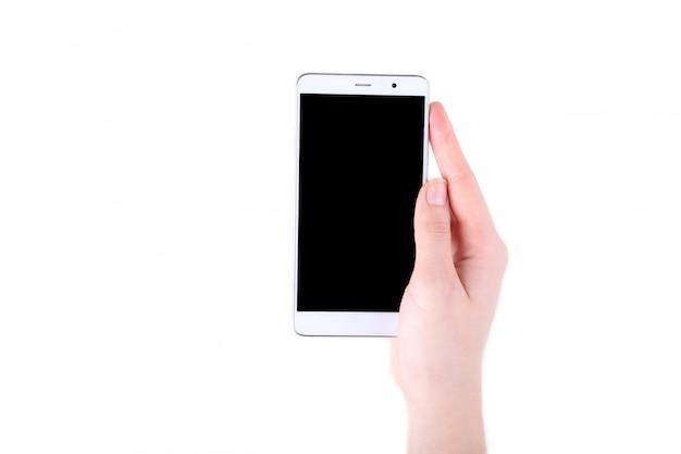 Weibliche hände, die handy mit dem leeren bildschirm lokalisiert auf weiß halten Premium Fotos