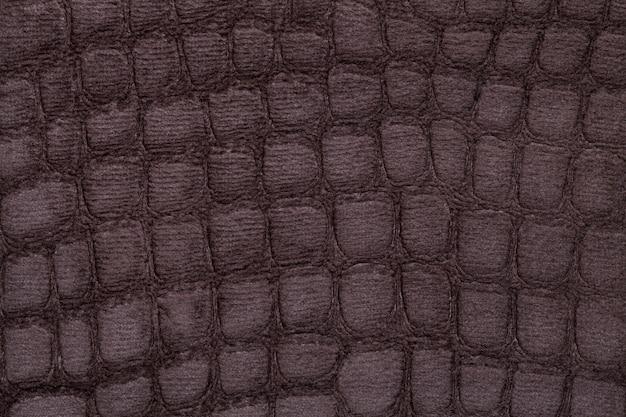 Weiches polsterungstextilmaterial browns, nahaufnahme. stoff mit muster Premium Fotos