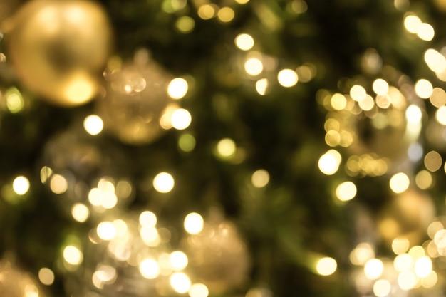 Weihnachten mit goldbokeh-lichthintergrund. weihnachten abstrakte unschärfe. Premium Fotos