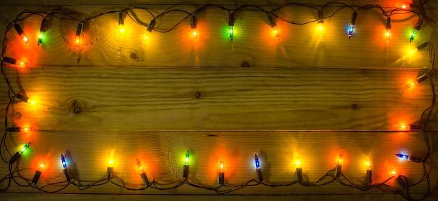 Weihnachtsbeleuchtung frame hintergrund. Premium Fotos