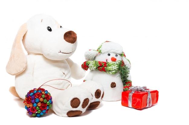 Weihnachtshund und schneemann Premium Fotos