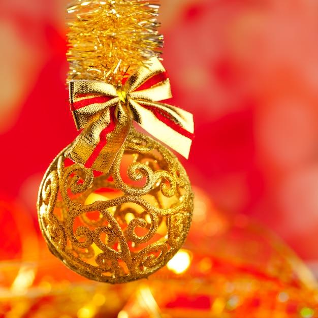 Weihnachtslametta goldene funkelnflitterschleife Premium Fotos