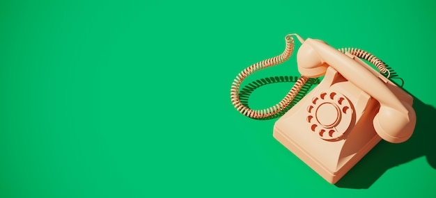 Weinlese-drehtelefon auf grünem hintergrund Premium Fotos